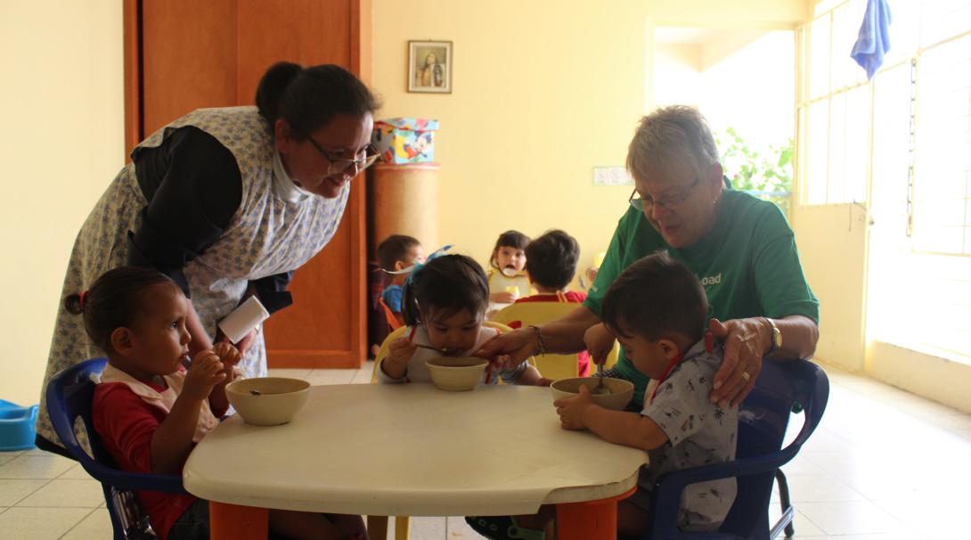 Senior volunteer taking care of children in a nursery during her Childcare project in Mexico.